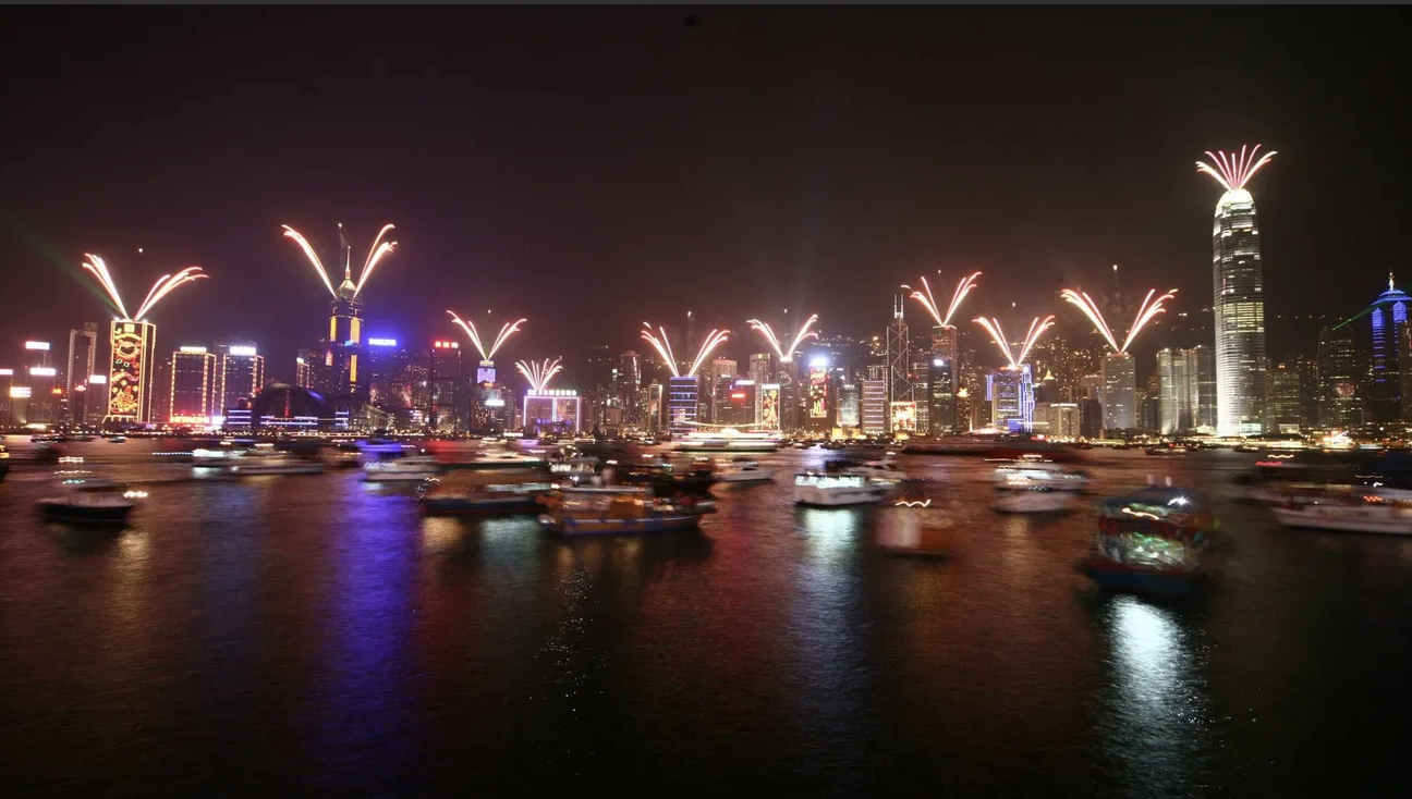 The Hong Kong skyline is illuminated by fireworks.